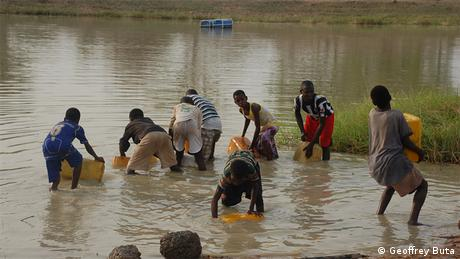 Villagers gather water in Ghana