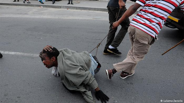 A man being dragged in Cape Town (Photo: Lulama Zenzile)