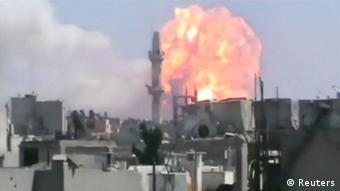 ATTENTION EDITORS - REUTERS CANNOT INDEPENDENTLY VERIFY THE CONTENT OF THE VIDEO, OBTAINED FROM A SOCIAL MEDIA WEBSITE, FROM WHICH THIS STILL IMAGE WAS TAKEN A still image taken from video posted on the Internet by opposition activists shows what they say is a ball of fire rising after an explosion in the central Syrian city of Homs on August 1, 2013. Forty people were killed and at least 120 people were wounded in an explosion at a weapons cache in the central Syrian city of Homs on Thursday (August 1), a group opposed to President Bashar al-Assad said. Amateur video posted on the Internet by opposition activists appeared to show a huge explosion in a neighbourhood inhabited mainly by Alawites - the same sect as Assad - blasting a fireball hundreds of metres into the air. REUTERS/Social Media Website via Reuters TV (SYRIA - Tags: CONFLICT) NO SALES. NO ARCHIVES. FOR EDITORIAL USE ONLY. NOT FOR SALE FOR MARKETING OR ADVERTISING CAMPAIGNS. THIS IMAGE HAS BEEN SUPPLIED BY A THIRD PARTY. IT IS DISTRIBUTED, EXACTLY AS RECEIVED BY REUTERS, AS A SERVICE TO CLIENTS