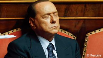 Italy's former Prime Minister Silvio Berlusconi (L) closes his eyes during a vote session at the Senate in Rome July 19, 2013. Interior Minister Angelino Alfano survived a no-confidence vote on Friday, averting a political crisis that could have brought down the fragile coalition government of Prime Minister Enrico Letta. Alfano, secretary of Berlusconi's centre-right People of Freedom party (PDL) which governs in an uneasy partnership with its traditional rivals in Letta's centre-left Democratic Party (PD), faced calls to resign over the hurried deportation of the family of a dissident Kazakh oligarch in May. REUTERS/Remo Casilli (ITALY - Tags: POLITICS TPX IMAGES OF THE DAY)