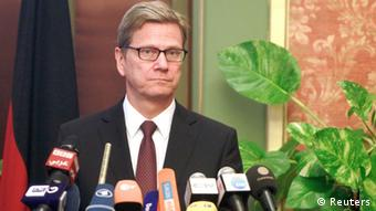 German Foreign Minister Guido Westerwelle looks on during a news conference with Egypt's interim Foreign Minister Nabil Fahmy in Cairo August 1, 2013. Germany urged Egypt to avoid the appearance of selective justice on Thursday amid a crackdown on deposed President Mohamed Mursi's Muslim Brotherhood, which remained defiantly dug in at a protest camp the police have orders to remove. REUTERS/Mohamed Abd El Ghany (EGYPT - Tags: POLITICS CIVIL UNREST)