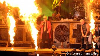 Heino and Rammstein on stage at Germany's Wacken festival for metal music (c) Carsten Rehder/dpa
