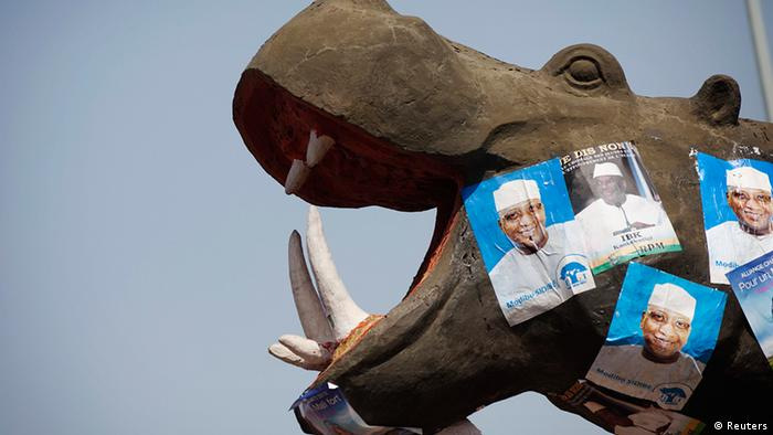 Electoral campaign posters are seen on a hippopotamus monument in Bamako July 23, 2013. Mali is due to hold presidential elections on Sunday. REUTERS/Joe Penney (MALI - Tags: POLITICS ELECTIONS)