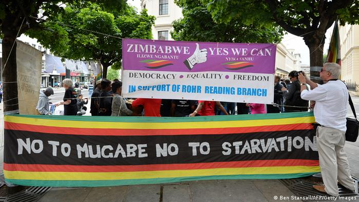 Protesters in London hold up a banner saying No to Mugabe, no to starvation (Photo: BEN STANSALL/AFP/Getty Images)
