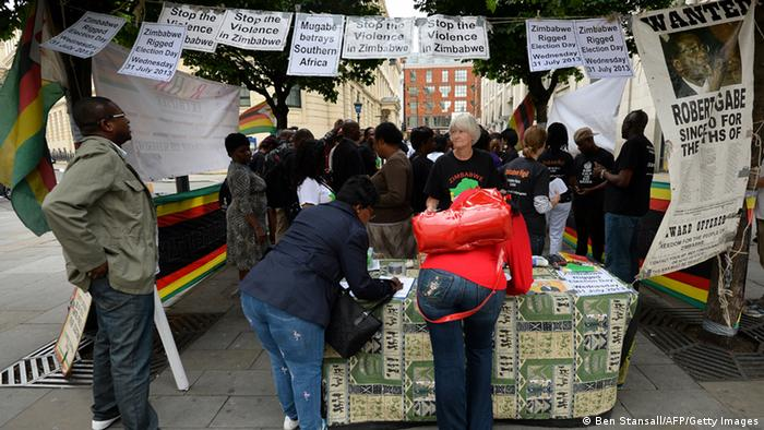 Zimbabweans in London sign a petition calling for a fair election (Photo:BEN STANSALL/AFP/Getty Images)