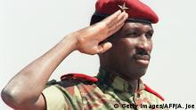 Captain Thomas Sankara, President of Burkina Faso, salutes 31 August 1986 upon his arrival in Harare for the 8th Summit of Non-aligned countries. Sankara was killed in October 1987 in a coup d'etat in which President Blaise Compaor?, his former comrade-in-arms, took power. In 1983, Compaor? helped his boyhood friend seize power from then President Jean-Baptiste Ouedraogo. (Photo credit should read ALEXANDER JOE/AFP/GettyImages)