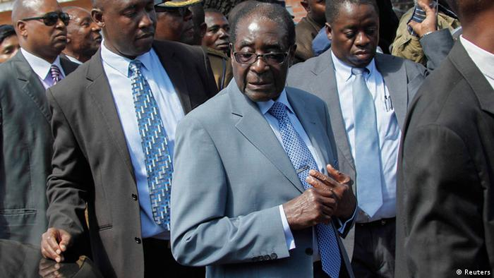 epa03808655 Zimbabwean President Robert Mugabe arrives to cast his ballot in the presidential elections at Mhofu Primary school in the capital Harare, Zimbabwe, 31 July 2013. Zimbabwe's 89 year-old President Robert Mugabe is seeking another term after thirty three years in power with his Zanu-PF party, whilst Prime Minister Morgan Tsvangirai leader of the Movement for Democratic Change (MDC) hopes to win and prevent this. EPA/AARON UFUMELI