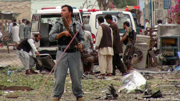 Security officials investigates the scene of an attack near the Indian consulate in the city of Jalalabad (photo via AP)