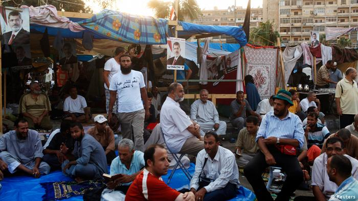 Supporters of deposed Egyptian President Mohamed Mursi sit near tents in their sit-in area around Raba' al-Adawya mosque, east of Cairo, August 3, 2013. Egypt's army-backed rulers and allies of its deposed Islamist president gave the first signs on Saturday of a readiness to compromise, pressed by Western envoys trying to head off more bloodshed. REUTERS/Asmaa Waguih (