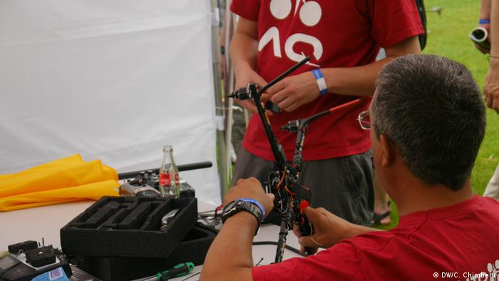A man building an arducopter at the 2013 Maker Faire in Hanover