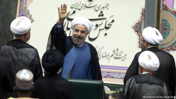 Iran's new president Hassan Rouhani waves to the members of the parliament after he took the oath of office at the Iranian Parliament in Tehran, Iran on August 4