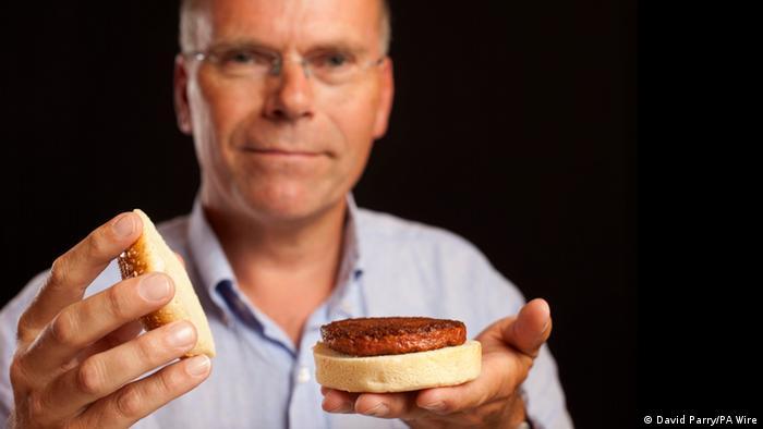 Professor Mark Post holds the first lab-grown hamburger