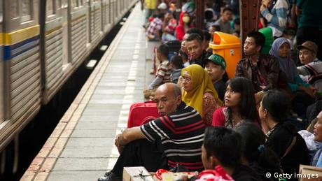 People crowd a rail platform in Indonesia (Photo: Ed Wray)