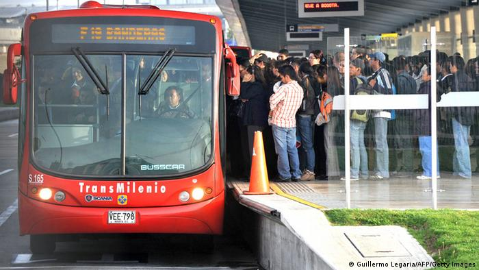 People board a bus inside a Transmilenio station (Guillermo Legaria/AFP/Getty Images)