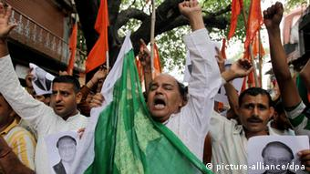 Activists of the Indian right-wing Hindu organization Shiv Sena shout anti-Pakistan slogans prior to burning a Pakistani flag during a protest against the death of five army soldiers in Jammu, India, 06 August 2013.