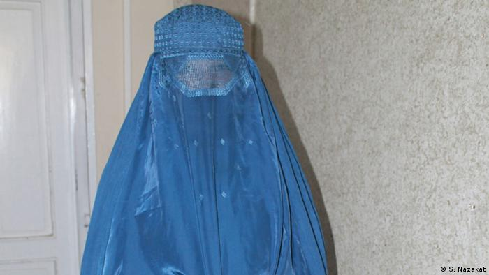 Afghan woman in burqa, trafficked over the border and sold into sex slavery. (Photo: Syed Nazakat)