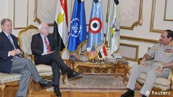 Egypt's Armed Forces General Abdel Fattah al-Sisi (R) meets with U.S. Senators' John McCain (C) and Lindsey Graham at the Ministry of Defense in Cairo in this August 6, 2013 handout picture provided by the Ministry of Defense. Republican senators Graham and McCain arrived in Cairo at President Barack Obama's request to meet with members of the new government and the opposition. The Muslim Brotherhood on Monday rejected pleas from international envoys to swallow the reality that Mohamed Mursi will not return as Egypt's president. The envoys from the United States and the European Union, trying to resolve a political crisis brought on by the army's overthrow of the Islamist Mursi a month ago, visited jailed Brotherhood deputy leader Khairat El-Shater in the early hours of Monday. REUTERS/Ministry of Defense/Handout via Reuters (EGYPT - Tags: POLITICS MILITARY) ATTENTION EDITORS - THIS IMAGE WAS PROVIDED BY A THIRD PARTY. FOR EDITORIAL USE ONLY. NOT FOR SALE FOR MARKETING OR ADVERTISING CAMPAIGNS. NO SALES. NO ARCHIVES. THIS PICTURE IS DISTRIBUTED EXACTLY AS RECEIVED BY REUTERS, AS A SERVICE TO CLIENTS