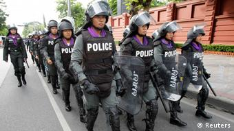 Thai riot policemen walk outside parliament in preparation for anti-government protests in Bangkok August 7, 2013. (Photo: Reuters)