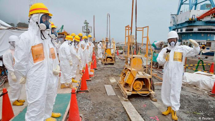 Members of a Fukushima prefecture panel, which monitors the safe decommissioning of the nuclear plant, inspect the construction site of the shore barrier, which is meant to stop radioactive water from leaking into the sea, near the No.1 and No.2 reactor building of the tsunami-crippled Fukushima Daiichi nuclear power plant in Fukushima, in this photo released by Kyodo August 6, 2013. Highly radioactive water seeping into the ocean from Japan's crippled Fukushima nuclear plant is creating an emergency that the operator is struggling to contain, an official from the country's nuclear watchdog said on Monday. Mandatory Credit. REUTERS/Kyodo (JAPAN - Tags: DISASTER BUSINESS POLITICS CONSTRUCTION HEALTH TPX IMAGES OF THE DAY) ATTENTION EDITOR - FOR EDITORIAL USE ONLY. NOT FOR SALE FOR MARKETING OR ADVERTISING CAMPAIGNS. THIS IMAGE HAS BEEN SUPPLIED BY A THIRD PARTY. IT IS DISTRIBUTED, EXACTLY AS RECEIVED BY REUTERS, AS A SERVICE TO CLIENTS. MANDATORY CREDIT. JAPAN OUT. NO COMMERCIAL OR EDITORIAL SALES IN JAPAN. YES
