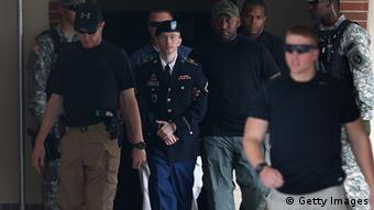FORT MEADE, MD - JULY 30: U.S. Army Private First Class Bradley Manning (C) is escorted by military police as he leaves his military trial after he was found guilty of 20 out of 21 charges, July 30, 2013 Fort George G. Meade, Maryland. Manning, was found not guilty of aiding the enemy, was convicted of wrongfully causing intelligence to be published on the internet, is accused of sending hundreds of thousands of classified Iraq and Afghanistan war logs and more than 250,000 diplomatic cables to the website WikiLeaks while he was working as an intelligence analyst in Baghdad in 2009 and 2010. (Photo by Mark Wilson/Getty Images)