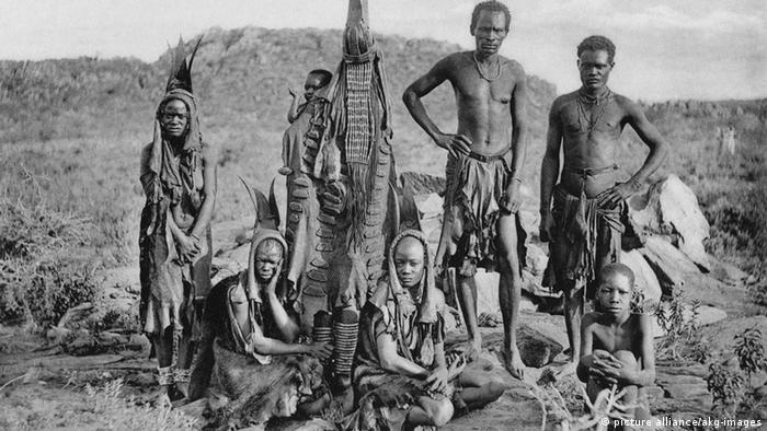 A black and white photo showing a group of Hereros