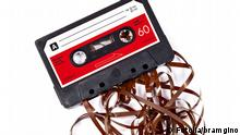 #50673294 - Old worn down eighties cassette with band pulled out © bramgino