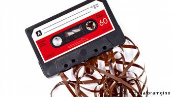 Old worn down eighties cassette with band pulled out © bramgino
