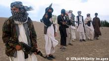 (FILES) This file photo taken on September 26, 2008 shows fighters with Afghanistan's Taliban militia standing on a hillside at Maydan Shahr in Wardak province, west of Kabul. US President Barack Obama on December 1, 2009 warned Afghanistan was not 'lost' but announced a swift 30,000 strong troop surge to 'seize the initiative' and finally end the brutal eight-year war. In a major televised address, Obama placed a major political and military bet that a fast influx of troops could defeat Al-Qaeda, crush a resurgent Taliban and pave a way home for US forces after years of bloodshed. AFP PHOTO / FILES (Photo credit should read STR/AFP/Getty Images)