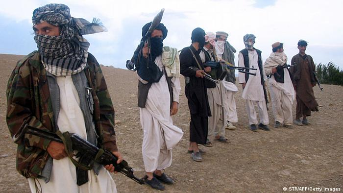 This file photo taken on September 26, 2008 shows fighters with Afghanistan's Taliban militia standing on a hillside at Maydan Shahr in Wardak province, west of Kabul. (Photo: AFP)