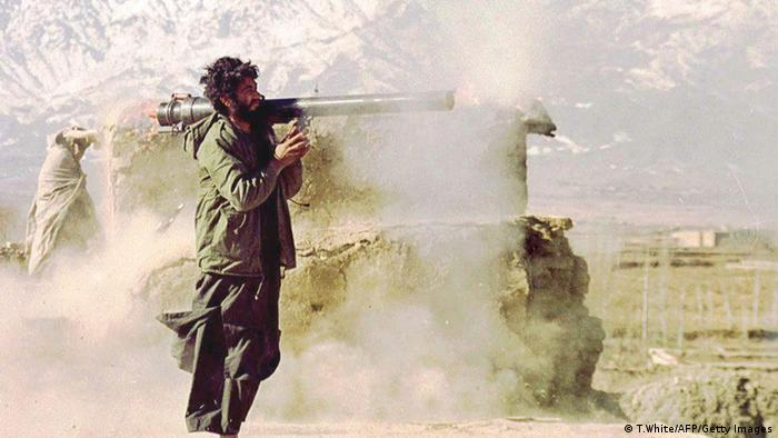 Flame splatters from both ends of 82mm recoilless rifle as a Taliban gunner fires at rival faction positions on the Kalakan frontlines 40 kilometres north of Kabul 04 December. (Photo: AFP)