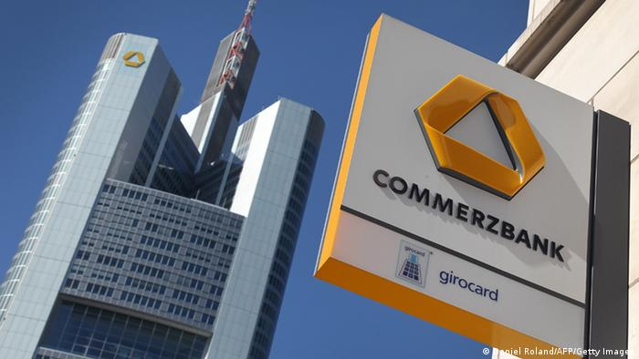 FILES - Picture taken on April 7, 2011 shows the logo of the German bank Commerzbank on a branch (R) and the headquarters (L) of the bank in Frankfurt/Main, western Germay. Germany's second biggest bank, Commerzbank, issued on August 10, 2011 a veiled profit warning for this year and next owing to the public debt crisis that has rocked financial markets. AFP PHOTO / DANIEL ROLAND (Photo credit should read DANIEL ROLAND/AFP/Getty Images)