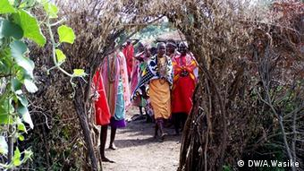 Masai women grouped together at the village entrance