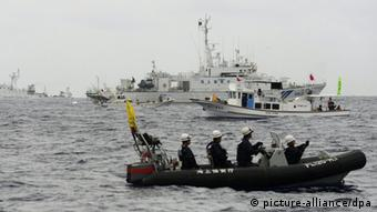©Kyodo/MAXPPP - 27/05/2013 ; ISHIGAKI, Japan - The Japan Coast Guard patrol ship Yoshino (front) sails to prevent the Chinese maritime surveillance vessel Haijian 46 (back L) from approaching Japanese fishing boats (2nd and 3rd from front) on May 26, 2013, in Japanese territorial waters near the Senkaku Islands in the East China Sea. Three Chinese maritime surveillance vessels sailed the same day into Japanese territorial waters near the Senkaku Islands, which are controlled by Japan but claimed by China and Taiwan. (Kyodo)