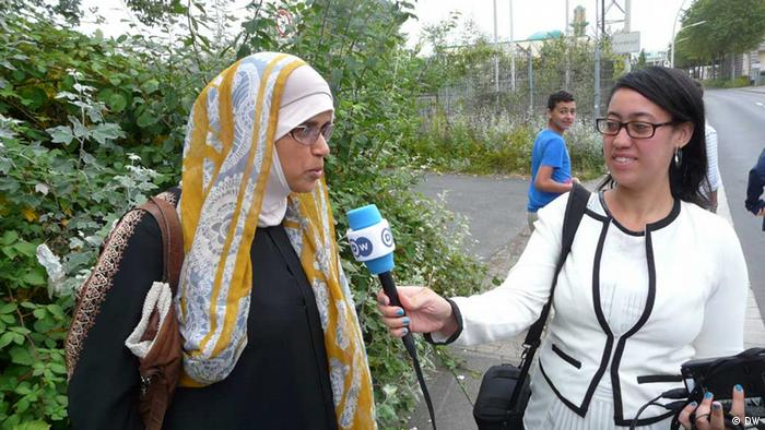 Deutsche Welle Reporter with a Muslim Woman in front of Al Mohajirin Mosque in Bonn/Germany . Copyright / Photographer : Asmae Boukhems / Mohamed Rashad Attaallah