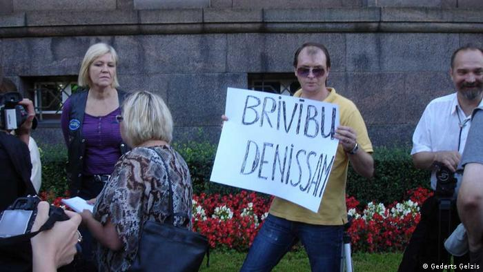 "Friends and supported of the alleged hacker Deniss Čalovskis gathering outside the government building on 6 August. They are protesting the plans to extradite the 28-year-old IT specialist to the US. This banner says – ""Freedom to Deniss"" Series Title in case there are several pictures about one topic (Hacker Latvia) Name of the photographer/or scource (Ģederts Ģelzis) When was the pic taken? (August 2013) Where was the pic taken (Riga, Latvia)"