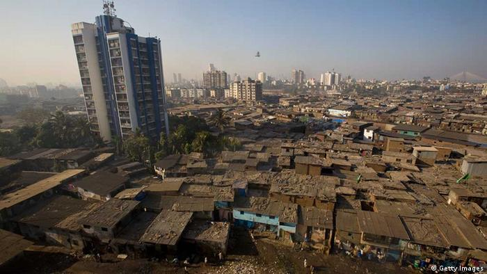 Men recycle waste on rooftops in Dharavi slum on February 3, 2009 in Mumbai, India. (Photo: Getty images)