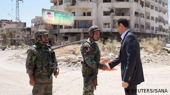 Syrian President Assad (right) is denying humanitarian aid (photo: REUTERS/SANA)