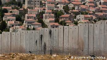 view of the Israeli 'separation barrier, or wall in the Shuafat Refugee Camp EPA/JIM HOLLANDER