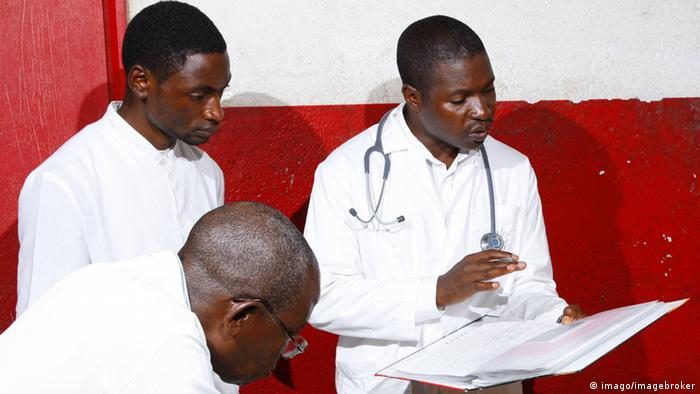 Doctors at Equitorial Guinea looking at the file of a patient.