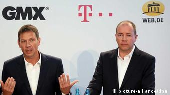 Telekom's CEO Obermann and United-Internet CEO Dommermuth during a press conference