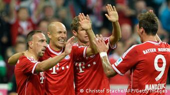 (L-R) Bayern Munich's French midfielder Franck Ribery, Dutch midfielder Arjen Robben, striker Thomas Mueller and Croatian striker Mario Mandzukic celebrate after the second goal for Munich during the German first division Bundesliga football match FC Bayern Munich vs Borussia Moenchengladbach in Munich, southern Germany on August 9, 2013. AFP PHOTO / CHRISTOF STACHE RESTRICTIONS - DFL RULES TO LIMIT THE ONLINE USAGE DURING MATCH TIME TO 15 PICTURES PER MATCH. FOR FURTHER QUERIES PLEASE CONTACT DFL DIRECTLY AT + 49 69 650050. (Photo credit should read CHRISTOF STACHE/AFP/Getty Images)