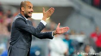 MUNICH, GERMANY - AUGUST 09: Josep Guardiola, head coach of Muenchen reacts during the Bundesliga match between FC Bayern Muenchen and Borussia Moenchengladbach at Allianz Arena on August 9, 2013 in Munich, Germany. (Photo by Lennart Preiss/Bongarts/Getty Images)