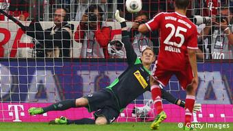MUNICH, GERMANY - AUGUST 09: Goalkeeper Marc-Andre ter Stegen of Moenchengladbach saves a penalty from Thomas Mueller of Muenchen during the Bundesliga match between Bayern Muenchen and Borussia Moenchengladbach at Allianz Arena on August 9, 2013 in Munich, Germany. (Photo by Alex Grimm/Bongarts/Getty Images)