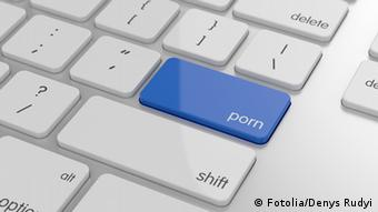 A white computer keyboard with a blue 'porn' button