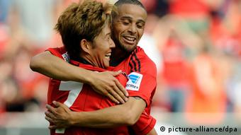 Scorer Heung-Min Son and creator Sidney Sam celebrate Leverkusen's second goal in Saturday's 3-1 win over Freiburg. (Photo via Marius Becker/dpa)