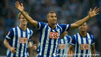 CAPTION CORRECTION - Corrects players name Hertha's defender John Anthony Brooks celebrates after scoring during the German first division Bundesliga match Hertha Berlin vs Eintracht Frankfurt in Berlin, on August 10, 2013. AFP PHOTO/ JOHN MACDOUGALL RESTRICTIONS - DFL RULES TO LIMIT THE ONLINE USAGE DURING MATCH TIME TO 15 PICTURES PER MATCH. FOR FURTHER QUERIES PLEASE CONTACT DFL DIRECTLY AT + 49 69 650050. (Photo credit should read JOHN MACDOUGALL/AFP/Getty Images)