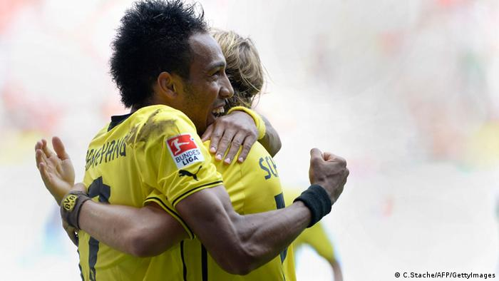 Dortmund's Gabunian Pierre-Emerick Aubameyang (L) and his teammate Dortmund's defender Marcel Schmelzer (R) celebrate after the first goal for Dortmund during the German first division Bundesliga football match FC Augsburg vs Borussia Dortmund in Augsburg, southern Germany on August 10, 2013. (Photo via CHRISTOF STACHE/AFP/Getty Images)