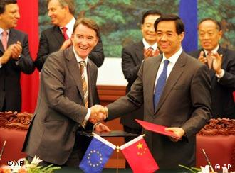 EU Trade Commissioner Peter Mandelson, left, exchanges documents with Chinese Commerce Minister Bo Xilai as leaders clap hands in the background during the EU-China signing ceremony in Beijing Monday, Sept. 5, 2005. Negotiators reached a deal to unblock Chinese textile imports at European ports - a problem that had threatened to sour a China-Europe trade-boosting summit. The deal reached by European Union and Chinese negotiators in Beijing would let about 75 million Chinese-made garments into Europe. Leaders in the background are from left: European Commission President Jose Manuel Barroso, British Prime Minister Tony Blair, Chinese Premier Wen Jiabao and Chinese Foreign Minister Li Zhaoxing. (AP Photo/Claro Cortes IV, Pool)