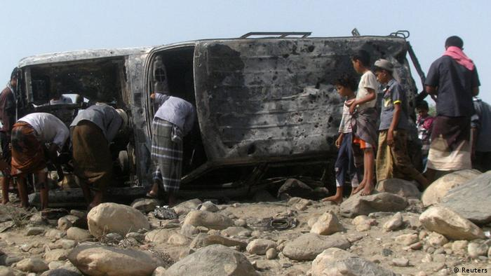 People gather at the site of a drone strike on the road between Yafe and Radfan districts of the southern Yemeni province of Lahj August 11, 2013. Local officials and residents in Yemen's southern Lahj Province said a drone destroyed a vehicle travelling on a mountain road late on Saturday evening killing its two occupants and bringing to 15 the death toll from four strikes in three days. REUTERS/Stringer (YEMEN - Tags: POLITICS CIVIL UNREST)