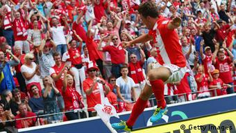 MAINZ, GERMANY - AUGUST 11: Nicolai Mueller of Mainz celebrates his team's third goal during the Bundesliga match between 1. FSV Mainz 05 and VfB Stuttgart at Coface Arena on August 11, 2013 in Mainz, Germany. (Photo by Alex Grimm/Bongarts/Getty Images)